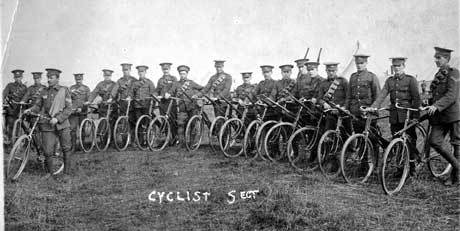 Soldiers get on their bikes to join their units.